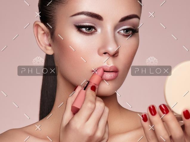 beautiful-woman-paints-lips-with-lipstick-PMB6YWP-1