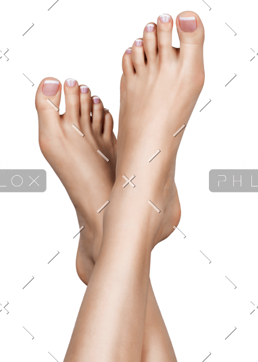 female-feet-with-white-french-pedicure-on-nails-PPHSX6U